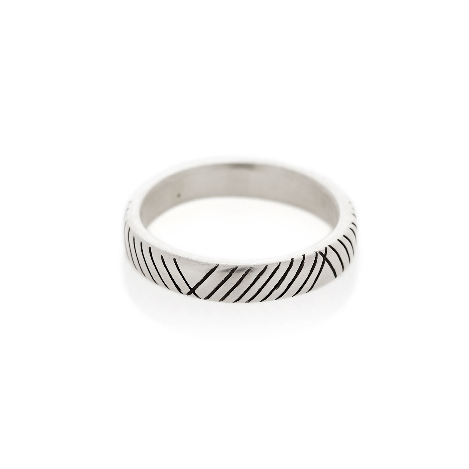 A 3.5 mm square profile men's band with diagonal hand-etched detail. Available in sterling silver, 9ct yellow gold and 9ct white gold with a brushed or polished finish.