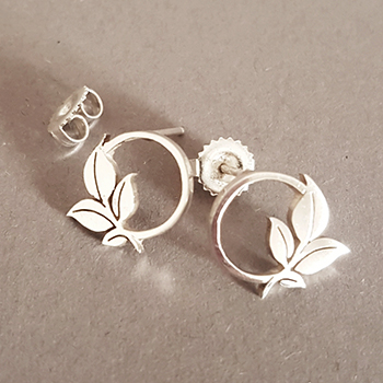 Circle with leaf stud earrings hand-cut in sterling silver.