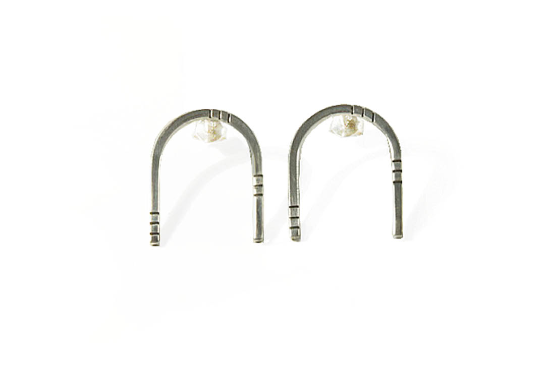 Sterling silver U shaped earrings with subtle line detail.