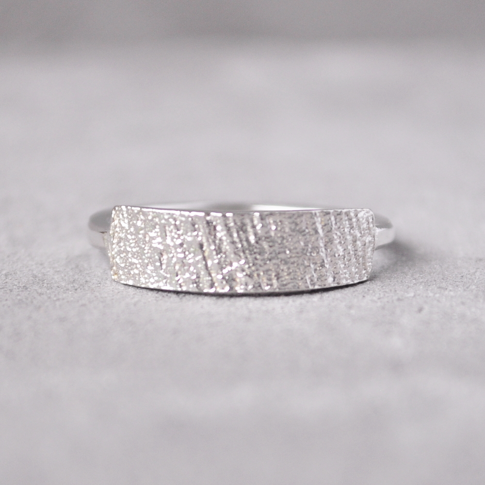 The ring face is a sterling silver casting of coconut fiber.