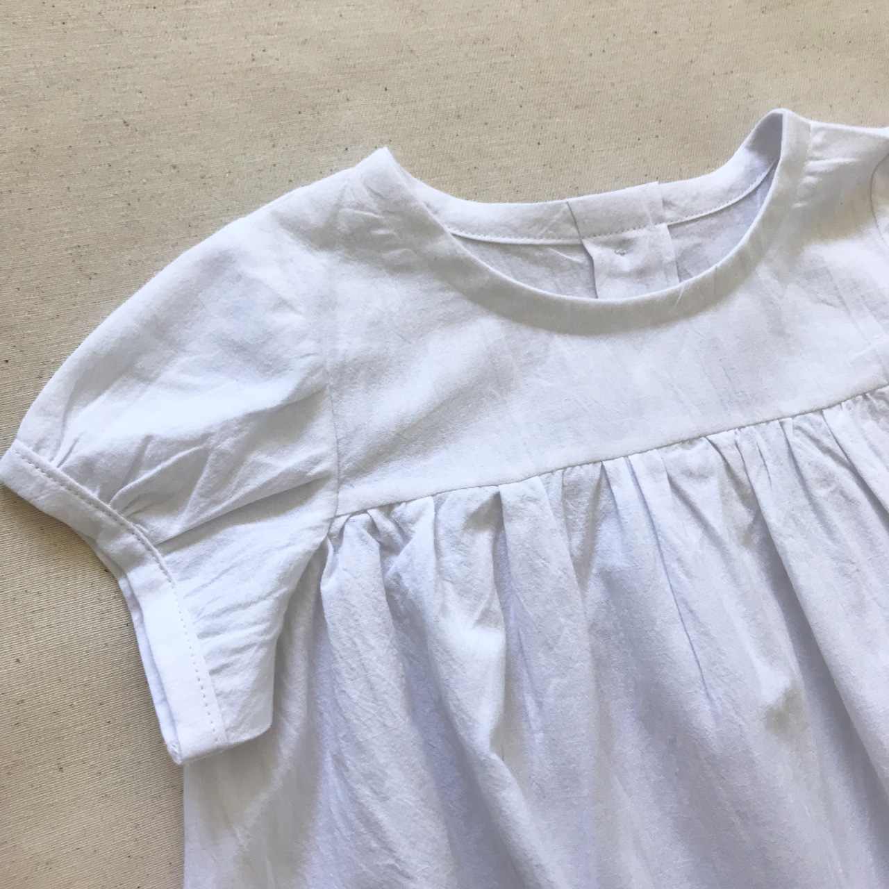 This little blouse top will go with any outfit.  Light weight and perfect for Spring / Summer days.