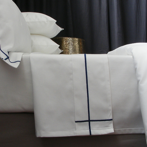 Inspired by the velvet depth of the African evening, we bring you the Midnight colour palette, Navy and White has always been an elegant combination.   Our Signature Collection is ultimate luxury, turning your sleeping experience into a sensual affair. Long lasting and easy to care for.    Colour - White with Navy Criss-Cross Satin Stitch detail  Item - Flat Sheets  Design - Oxford, Criss-Cross Satin Stitch   Leadtime - Approx. 15working days + delivery  Taking care of your linen