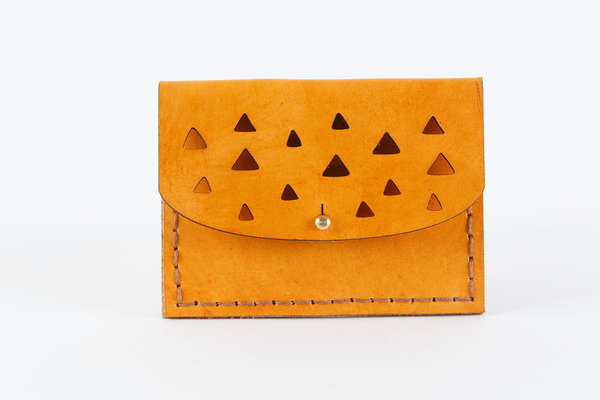 The Triangle Mini Purse is hand stitched and a great size for your small essentials. Can be used as a coin purse, for cards/cash or to store rings, etc. Perfect as a gift.