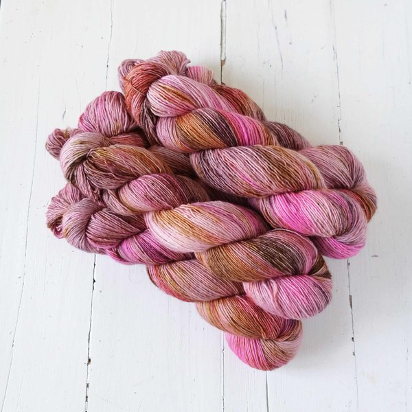 I wanted to capture something of the sharpness of hickory smoke - and so this variegated colourway is a blend of caramel, rich woody browns and pinks, with a pop of hot pink here and there. Some delicate speckles provide texture.