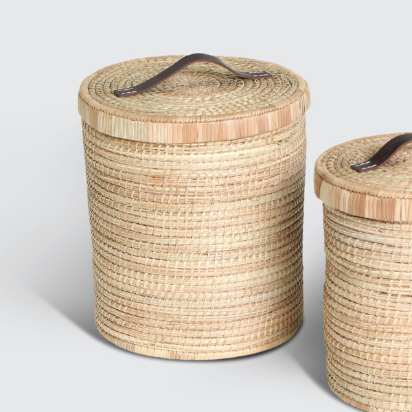 R 245 / R 465  A strong, round storage basket. Sturdy base, tidy look with leather-handled top cover. Woven with Palm. Great for things like toys, accessories, or as a general tidier.  REQUEST DETAILS  Product code & Dimensions   ML/BMWLM 300mm (d) x 350mm (h) ML/BMWLS 250mm (d) x 300mm (h)