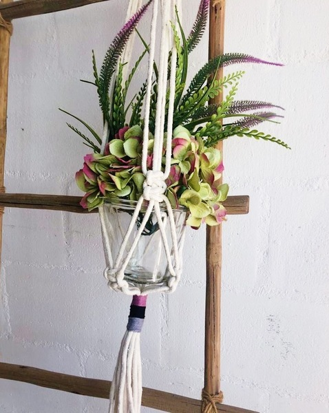 Beautiful macrame pot hanger, hand-tied by workers upskilled through our community training & job creation projects.