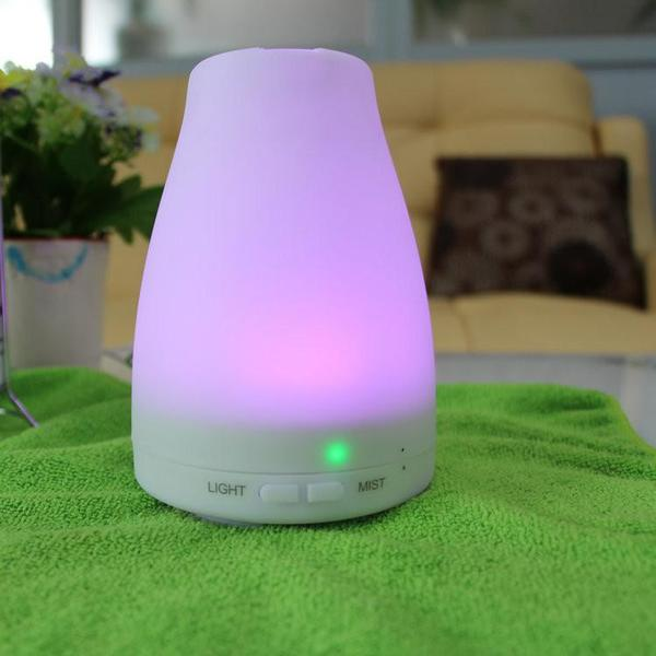 """This ultrasonic aroma diffuser is a second generation essential oil diffuser that produces more mist and aroma than previous models. It is the most ideal way of adding divine aroma to your bedroom, kid's room, bathroom, office and living room.  Product Features:   Uses ultrasonic diffusing technology which means no naked flames or heat. Add water and a couple drops of essential oil for aroma diffusing or just water for humidifying. Has 7 colour changing lights. Use as one solid colour or use loop function to fade gradually through all the colours. Three settings toggled by the mist button: intermittent mist, continuous mist, off. Use as night light only with """"mist off"""" setting. The device will protect itself by automatically switching off if the water runs out. The perfect addition to your home, office, beauty salon or guest house. Essential oils have amazing health benefits for you.    Product Specifications: - Capacity of water tank: 120ml  - Dimensions: 10 x 14 cm - Noise level: Less than 35 dB - Input power: AC 100-240V 50/60HZ - Advanced ultrasonic technology: 2.4MHz - Working time: 6 hours intermittent mode, 3hours continuous mode  *Use pure essential oils only. Use any scent of your choice.  Free 5ml essential oil included. You should get about 100 drops out of a 5ml bottle.  Click here to see our range of essential oils.    Add item(s) to your cart below to proceed to the checkout process or email your order to info@aromadiffusers.co.za"""