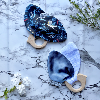 The Tiger Lily Bird Teether comprises of an untreated, hard wood teething ring and soft bird ears made from a combination of cotton muslin and satin.