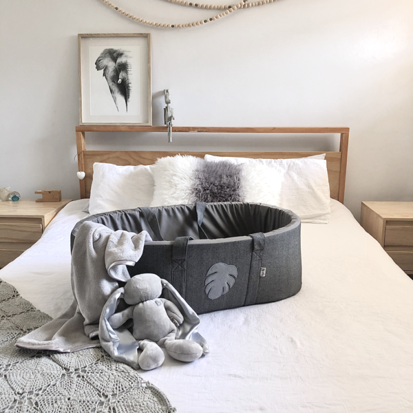TheTiger Lily Carry Cotis perfect for your little person's first few months. Constructed from cotton with a soft cotton inner and mattress cover, your little one will enjoy the transition from womb to cocoon. The carry cot is large enough to allow your baby space to grow and cozy enough to create a safe, secure environment for sleeping. Place the carry cot near you or on the bed next to you so that your baby can still hear your movements. As your little one settles into life on the outside, place the carry cot inside the cot for an easy transition. The carry cot comes standard with an interior pocket, a mattress and cover, as well as a stiff base. While the felt motif is typically a star, bird or monsterra leaf ... we're happy to consider custom requests.  Wash Care: Dismantle the carry cot to wash the outer fabric components on a gentle, warm machine wash  Approx. Dimensions: 720mm (length) x 400mm (width) x 260mm (height)  Shipping: As this item is bigger than the courier bagthere is a shipping surcharge.  Disclaimer: All products are handcrafted(with love!) and as a result there may be slight variations in size