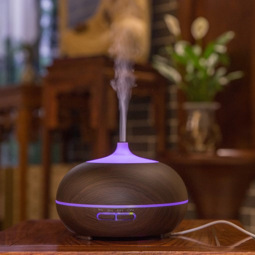 This lovelywood grain ultrasonic essential oil diffuser fills the space with a lovely fragrance that can lift the mood and relieve stress, perfect for masking stubborn smoking and pet odours, get great and peaceful nights' sleep surrounded by the aromatic fragrance.    Features:    Relax and enjoy – 7 colour changing lights provides a relaxing setting. You can choose your favourite colour or have the colours rotate.   Simply add a few drops of your favourite essential oil to create a relaxingmind and body aromatherapy experience.   Humidify – Dry air can cause your skin to crack. The diffuser can be used without essential oil to add moisture to the air.   Auto shut off when the water runs low – adds to safety, energy efficiency and peace of mind.   Four modes to diffuse mist – 1 hour, 3 hours, 6 hours or stay on.   No filters required and works with ordinary tap water.       Specifications:  - Size: 17 x 13 (cm), 360g, not real wood  - Capacity: 300ml  - Working time: Up to 10 hours     Benefits of Using an Essential Oil Diffuser:  - Wards of illness  - Freshens up the air  - Helps sleep  - Keep you cool  - Pain relief  - Stress relieve  - Mood elevating  - Relieve snoring  - Repels insects  - Safer alternative to candles and incense  - Mental focus    *Use pure essential oils ONLY. Use any scent of your choice.    Add item(s) to your cart below to proceed to the checkout process or email your order to info@aromadiffusers.co.za
