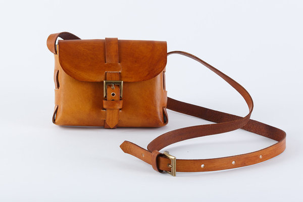 The Mini Sling Bag is cleverly folded without any stitching at all. It is a handy mini bag, just big enough to safely hold your small essentials. 