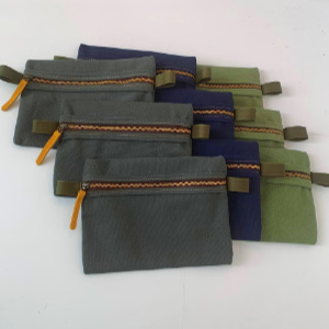 A large zippered canvas pouch perfect for make-up. Strong and solidly made with a metal sipper and pull tags at each end for ease of use. This pouch comes in 5 colors. 