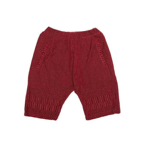 Below the knee cropped shorts. Finished with deep internal side pockets and elasticated drawstring.Cut from a luscious chenille throw milled bySouth African heirloom textile mill, Mungo.  Handmade in Cape Town.