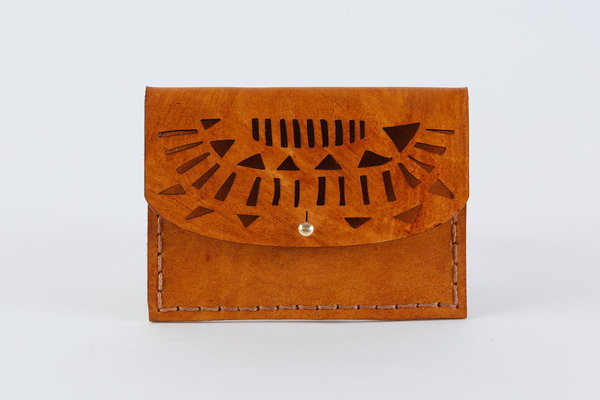 The Temple Mini Purse is hand stitched and a great size for your small essentials. Can be used as a coin purse, for cards/cash or to store rings, etc. Perfect as a gift.