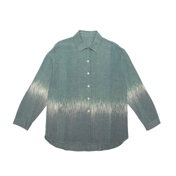 A button up shirt, finished with a curved hem.Cut from an organic100% Indonesian cotton, and dyed at theTarum Balidye house.  Handmade in Cape Town.