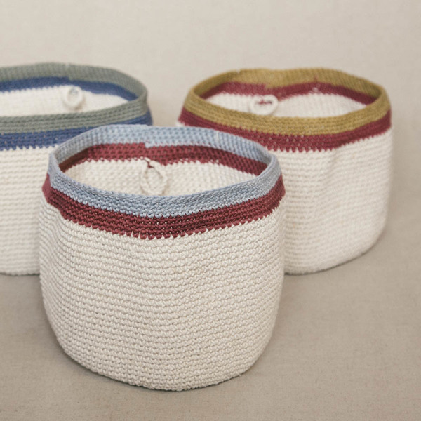 Lapoplap's original hand crocheted baskets. Beautifully display bread rolls, toast, fresh fruit, a vase of flowers or pot plant, toiletries, or smaller items in this unique, stylish basket. Use as a centrepiece in your table decor or to organise and brighten that special corner. Keep bread warm on your table and easily pop them in the microwave bread-and-all to heat as necessary.  These baskets make excellent gifts  Machine washable. Microwave friendly.  Material type: Cotton & Linen Diameter: Approximately 24cm Height: Approximately 15-18cm  Handmade in South Africa.  Delivery:  Courier delivery in Cape Town within 5 business days: R50 per order Courier delivery to the rest ofSouth Africa within 5-10 business days: R65 per order
