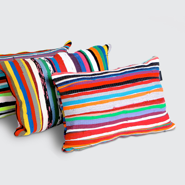 Filled / R 660  Flat / R 605  Brighten your work, play, or rest space with our Pumla scatter cushions, quilted from strips of our signature fabric. Made with different colour combinations on either side – have fun flipping your Pumlas to suit your vibe. Available with a quality upcycled inner cushion, or flatpacked as the cover only.  REQUEST DETAILS  Dimensions   600mm (w) x 400mm (l)   Product code:   Filled: C6040S Flatpack: CC6040S    << < Back to Cushions