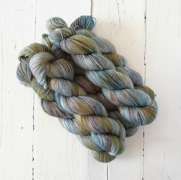 Shipwrecked is a light to medium variegated colourway that combined notes of pale teal, silvery teals, and darker teal with delicate layers of gold and pale brown. It will combine well either with Galleon, Smokey Teal or Erebus.