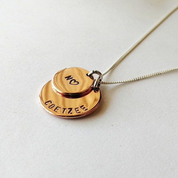PUNCH DISCNecklaces are hand stamped on a brass, copper or silver disc. They are 15mm or 20mm in diameter.  They come on a sterling silver chain in the length of your choice (40, 45, 50 or 55 cm)!  We have 3 letter sizes available: 1mm, 2mm and 6mm. Please specify which size you would like when placing your order, as well as the letter or wording you would like on your disc.  Every necklace purchased is packaged in a jewellery box, making it ready for gifting.  As necklaces are custom made to your specifications, please allow 2-4 days for manufacturing and 2-3 days for delivery!  Please supply your choice of chain length when placing your order! (See our FAQ section), as well as the name / initial you want stamped on your ring!  *PLEASE NOTE: Letters are stamped by hand. We can't guarantee perfection, but we can guarantee that attention to detail is of the highest importance when creating your jewellery piece.