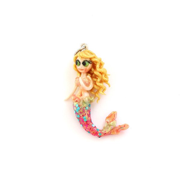 Each of our mermaid necklace charms are carefully hand crafted from polymer clay and decorated with iridescent glitter. This siren from the ocean is made to be treasured and bring a hint of ocean magic to any outfit. You can choose to buy just the charm on it's own, add a sterling silver bracelet or 45cm sterling silver chain by selecting your desired option