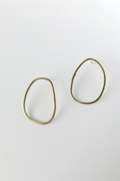 A mini version of ourrad semi asymmetrical Olive earring. These boast a sophisticated yet modern aesthetic. Wear alone for a subtle nod to all things classy and cool.  - Material: Silver  - Solid sterling silver ear post  - Approx. 3cm long