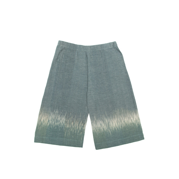A simple wide legged kids trouser, equipped with an elasticated waistband.Cut from an organic100% Indonesian cotton, and dyed at theTarum Balidye house.  Handmade in Cape Town.