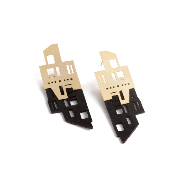Cape Town streets are lined with buildings from show stopping design feats to functional office blocks and residential spaces. This piece pays homage to the unnoticed buildings, those we walk past daily and have never really looked at. Available in yellow gold plated brass with sterling silver studs and paired with genuine South African leather. Size: 8cm long x 2.5cm wide