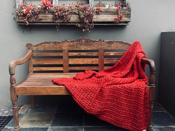 Hand crocheted, pure cotton chunky throw. An ideal accessory in your living space.  Colour: Red Coral  Texture: V-Stitch  Size: 115 cm x 140 cm (As theproducts are individually handmade, size may differ up to 10%)  Weight: 1.5 kg