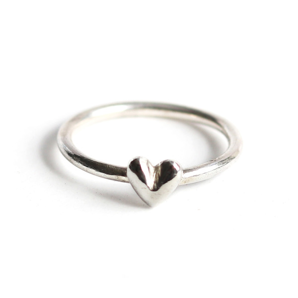 Hand sculpted heart cast into sterling silver and attached to a round band and polished to a high shine. Kindly state your ring size (in letter size) in the comment section if you don't find your ring size in the options listed.