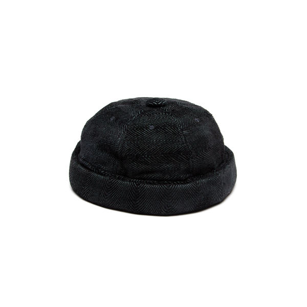 Short cap that blends the key features of a beanie and a cap. Finished with anadjustable leather backstrap.Cut from a luscious chenille/cotton throw milled in Plettenberg Bay, South Africa.  Handmade in Cape Town.