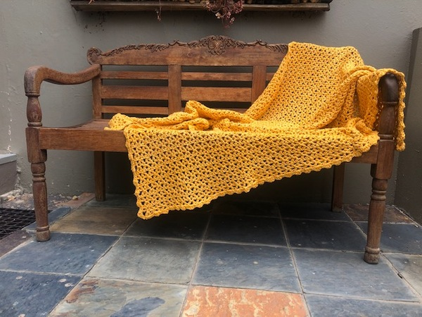 Hand crocheted, pure cotton chunky throw. An ideal accessory in your living space.  Colour: Sunshine  Texture: V-Stitch with Scalloped border  Size: 115 cm x 140 cm(As theproducts are individually handmade, size may differ up to 10%)  Weight: 1.5 kg