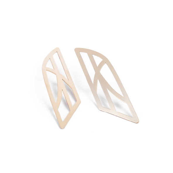 Soft lines - the antithesis to the hard edges we expect from a city. Look carefully and you'll notice the beautiful curves in the buildings, the doorways, the streets. Available in yellow gold plated brass with sterling silver studs. Size:  6.5cm long x 2cm wide