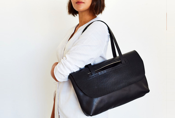 The Everyday Shoulder bag in onyx game skin is entirely hand stitched. Features a zip closure and a vegetable tanned slip through flap for extra protection of your valuable goods.