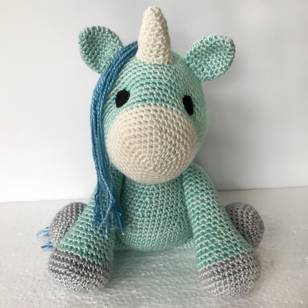 Legend has it that unicorns were created to be the guardians of people who have magic within them. To bring out the beauty, purity, strength and magic in those who believe. Finley is looking for his special person to love and protect. More than that, he wants a best friend.  When sitting, Finley is approximately 17cm tall.  Finley is handmade in a 100% natural bamboo yarn. His eyes are made of felt, not beads, so he is safe for children.  ***Colour may vary slightly from photos***