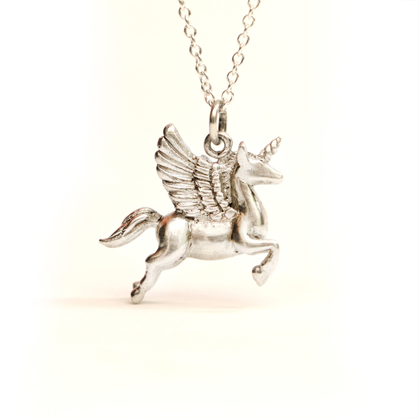 The Leaping Pegasus charm with a unicorn horn, was lovingly hand sculpted from polymer clay in 3D and cast into solid sterling silver.  There is a wonderful energy that encompasses the leap year, which I channeled while creating this magical creature, in the hopes that it will bring the wearer great success and courage to leap into any opportunity!  Please note, you can purchase just the charm on its own, or as a necklace or bracelet option. The sterling silver charm measures 2.5 x 2cm.