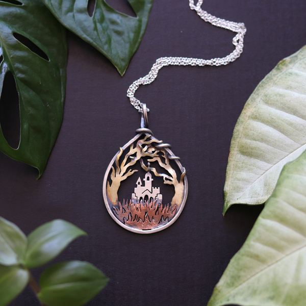 This fairy tale castle is hidden far off behind the whimsically intertwined branches, amongst the wild grasses. This piece represents the beauty in mystery and hidden gems...