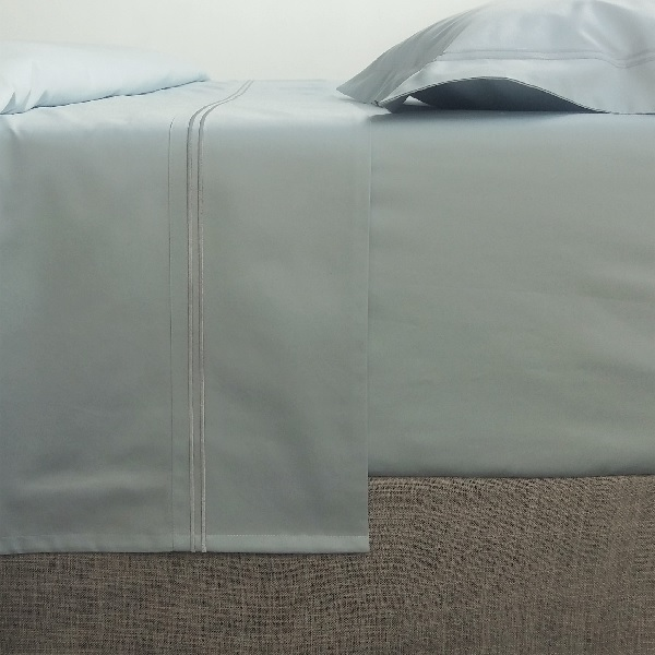 Glimpse the beauty of a bed enrobed in the softest blue hue and let it beckon you to it. Our Signature Collection in Breeze, is the ultimate in luxury, turning your sleeping experience into a sensual affair.  Long-lasting and easy to care for.
