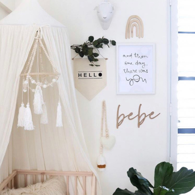 Our handmade, monochromatic Tassel Baby Mobiles are the perfect addition to any nursery. The simple contrast between natural wood beads and the tassels and pompoms are sure to delight both baby and parents alike. The tassels are handmade from 100% hand-dyed bamboo yarn (such a gorgeous sheen!). A gentle breeze (window or fan!) will ensure subtle movement of the mobile which encourages some stimulation for your little as he/she tracks the motion of the tassels.