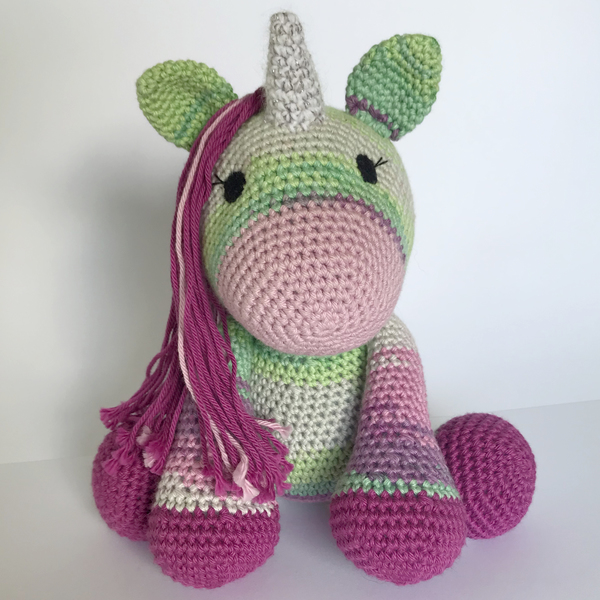 Legend has it that unicorns were created to be the guardians of people who have magic within them. To bring out the beauty, purity, strength and magic in those who believe. Raspberry is looking for her special person to love and protect. More than that, she wants a best friend.  When sitting, Raspberry is approximately 21cm tall.  Raspberry is handmade in a 100% cotton. Her eyes are made of felt, not beads, so she is safe for children.  ***Colour may vary slightly from photos***