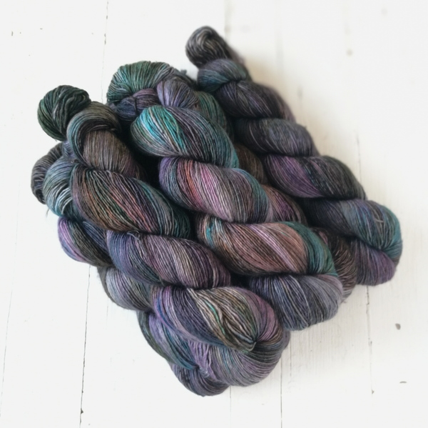 Ourobouros is one of my current favourites - it is a dark layered grey with a twist... it comprises of teals, strange pinks and rich purples hidden within a cloak of muting grey and charcoal shades. Darker speckles make this a special colourway to use ofr interesting contrasts.