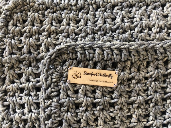 Hand crocheted, pure cotton chunky throw. An ideal accessory in your living space.  Colour: Dark Grey  Texture: V-Stitch or Square stitch  Size: 115 cm x 140 cm (As theproducts are individually handmade, size may differ up to 10%)  Weight: 1.5 kg