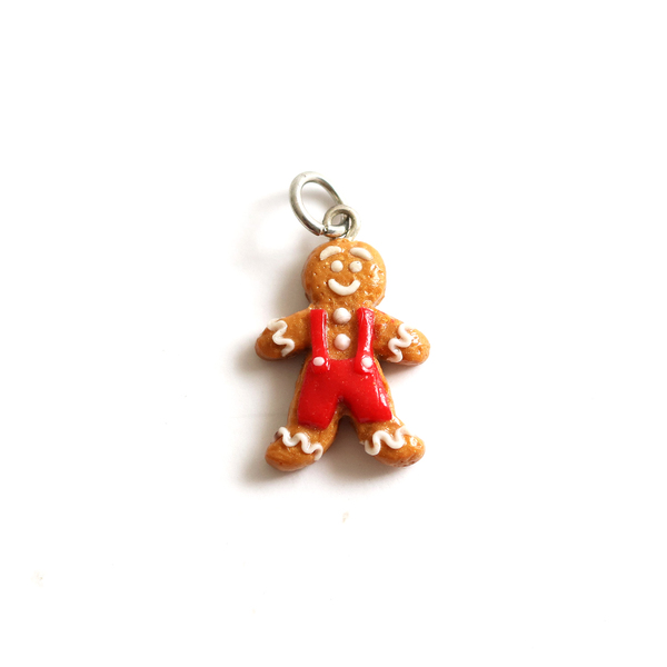 These totally adorable gingerbread men charms are handmade from polymer clay.