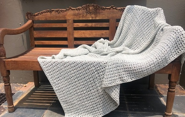 Hand crocheted, pure cotton double knit, summer weight throw. An ideal accessory in your living space.  Colour: Stone  Texture: Variety or V-Stitch  Size: 120 cm x 160 cm (As theproducts are individually handmade, size may differ up to 10%)  Weight: 1kg