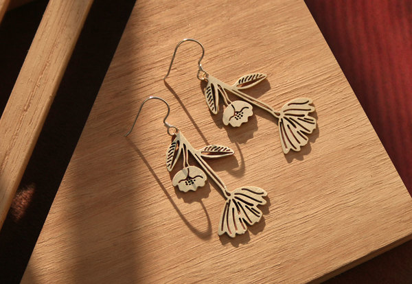 Sterling silver hooks with a brass or stainless steel Papaver pendants.