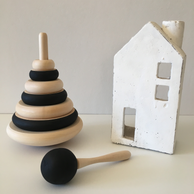 A Wood Ring Stacker on a curved base, the perfect size for small hands. Made from Linden wood and hand painted with non-toxic, water-based chalk paint. Encourage your little one to develop their fine motor skills and their visual &spacial perception while having fun! Not only does this product look good on a shelf but it's sure to become a favourite past time.  Approx. Dimensions: 150mm wide x 180mm tall  Disclaimer: All products are hand painted (with love!) and as a result there may be slight variations in pattern and colour