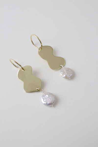 Introducing a new mini edit of pearl earrings, designed from sterling silver+ sculptural brass shapes andunexpectedly pretty freshwater cultured pearls.  Freshwater pearls are solid nacre, they are quite durable, resisting chipping, wearand degeneration.They are auniquerocky shape with anethereal opalescence, making for the perfect gift or a refined personal amulet.  Small round baroque freshwaterpearls, pin set in solid sterling silverand hangingfrom a gold-plated brass shapey shape and 15cm sleeper hoop. All our gold plated hoops have a base of sterling silver.