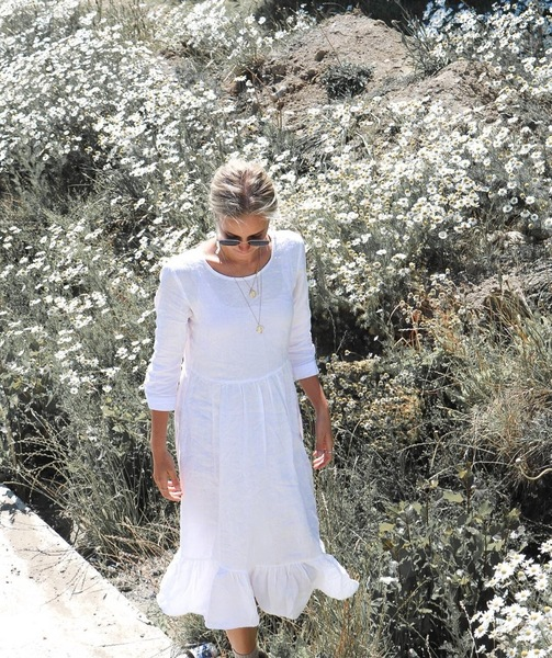 The Antú Dress  Available in white and musk.   100% linen Loose/relaxed fit Drop waist Bottom frill Back button Gabrielle wears a size medium      Size Small Medium Large   Shoulder 35cm 38cm 41cm   Bust 45cm 48cm 51cm   Waist 43cm 46cm 48cm   Length 108cm 112cm 116cm   Frill 22cm 22cm 22cm
