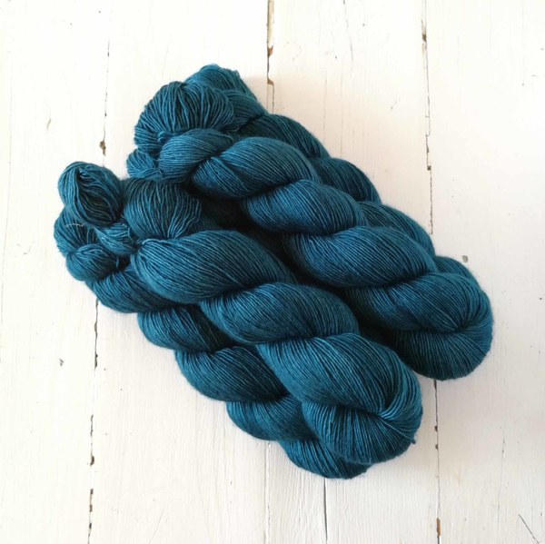 Erebus is a dark, very rich shade of dark teal. I have used it for a number of projects - it's the one knitting friends are always asking me about! :)