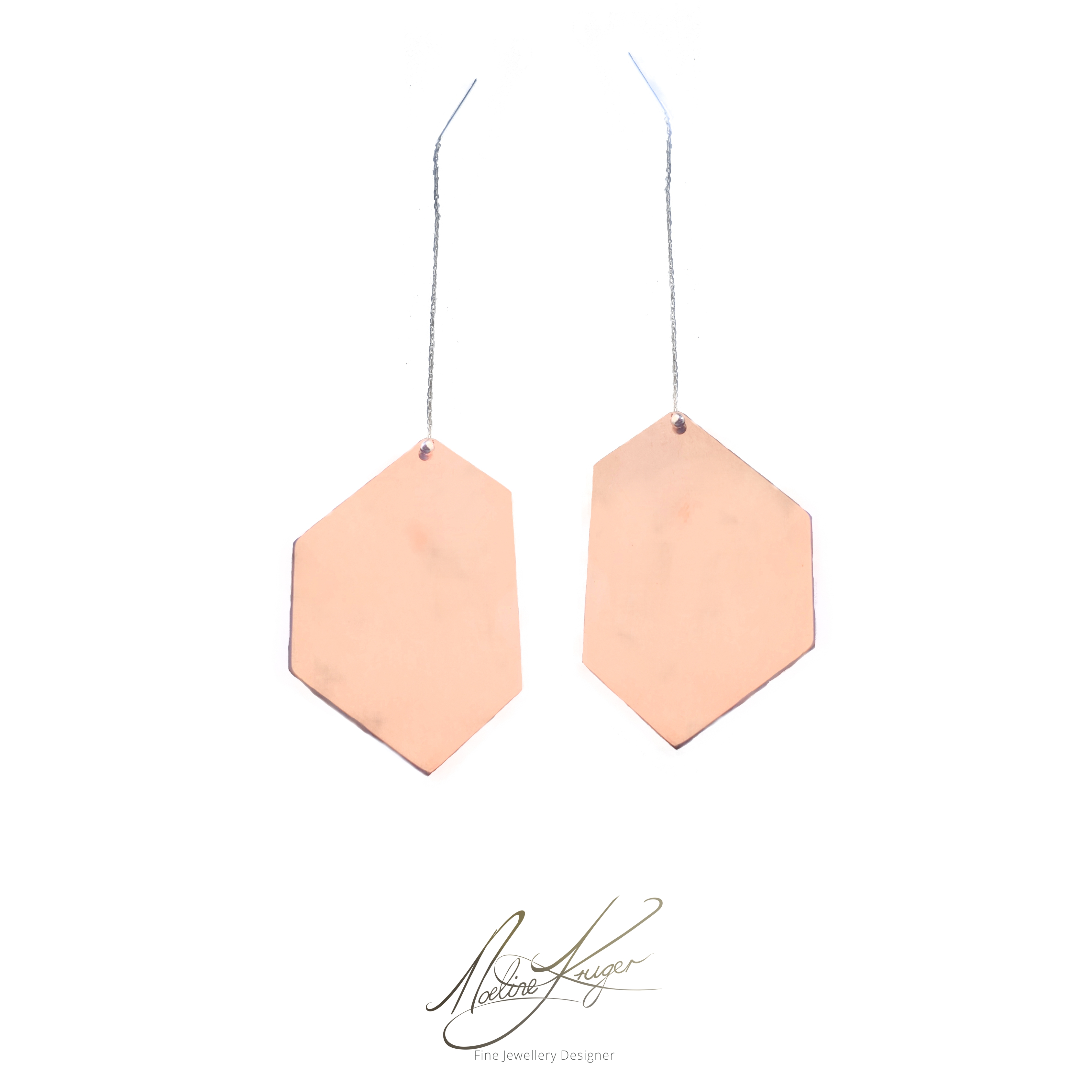 These geometric minimalist copper earrings are totally unique and one of a kind. They are light and comfortable to wear. They are hand cut in unique forms with a lacquer finish. The posts and butterfly backs are made from sterling silver.