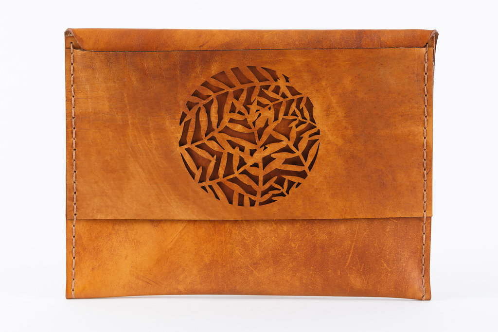 Secret Garden Clutch  TheSecret Garden Case ishand crafted usinglocally sourced vegetable tanned cow hide.  Dimensions: H 20cm x W 28cm x D 0.5cm  Please note that all products are made to order and can take between 7 and 14 days to finish before shipping. Once your order has been sent we will send you the waybill number for tracking purposes. We use Dawn Wing couriers for deliveries in South Africa. Delivery time is one to three days, depending on location. Deliveries are made between 9am and 5pm from Mondays to Fridays.  We also ship internationally. Please email us for international shipping details and rates.   Please note thatIlundi products aremade with the finest quality materials available. Any irregularities in the colour or in the grain are normal characteristics of natural leather. Leather items may have wrinkles, scars or scratches, that are an inherent quality and natural beauty of the hide.